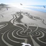 Imágenes de arte efímero en arena
