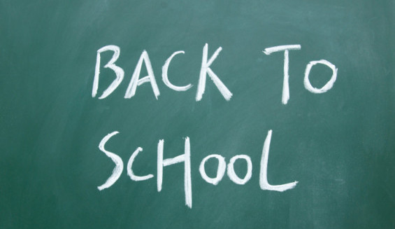 back to school title written with chalk on blackboard