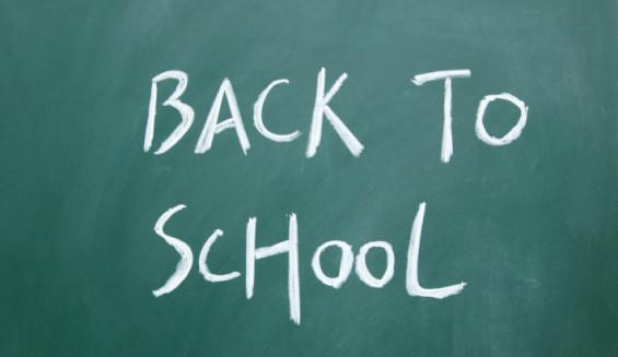 back to school title written with chalk on blackboard