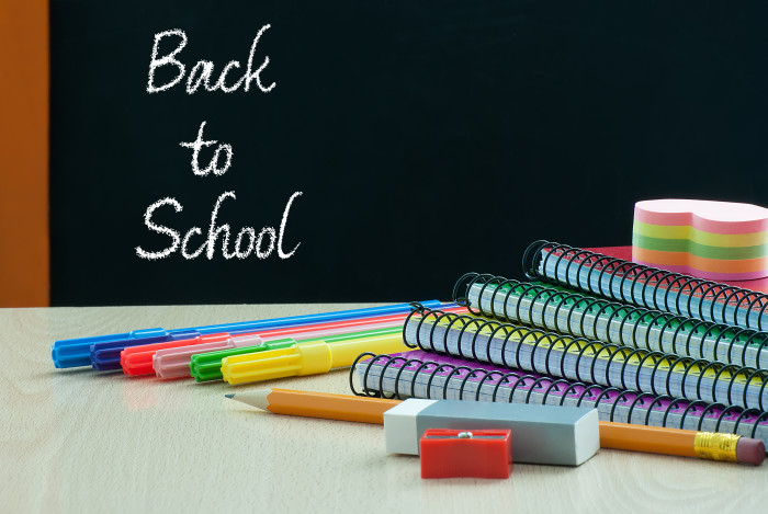Back to school with school supplies on wooden desk