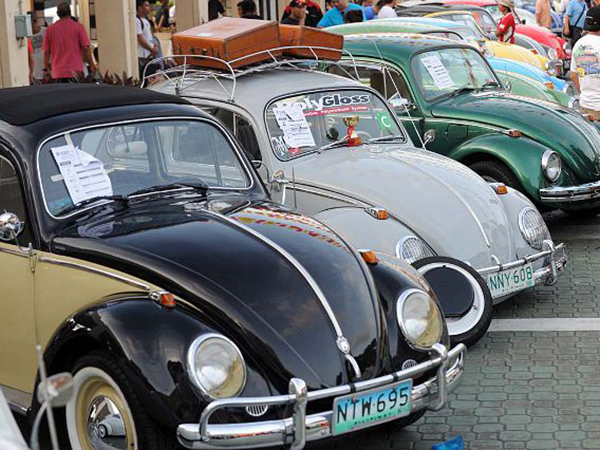 Vintage Volkswagen Beetle cars are parked for an all Volkswagen car show in suburban Manila on December 9, 2012. Clubs all over the country gather every December for the event, with more than 200 Volkswagens on display.   AFP PHOTO / JAY DIRECTOJAY DIRECTO/AFP/Getty Images ORG XMIT: