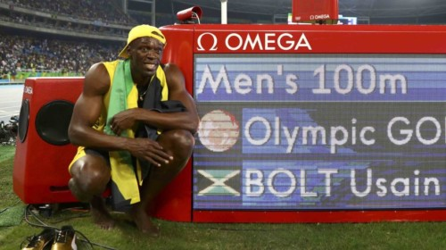 2016 Rio Olympics - Athletics - Final - Men's 100m Final - Olympic Stadium - Rio de Janeiro, Brazil - 14/08/2016. Usain Bolt (JAM) of Jamaica poses next to the electronic result board after winning the gold medal in the race  REUTERS/Kai Pfaffenbach   FOR EDITORIAL USE ONLY. NOT FOR SALE FOR MARKETING OR ADVERTISING CAMPAIGNS.