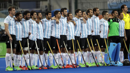 Argentina hockey team listen to their national anthem during a men's field hockey gold medal match against Belgium, at 2016 Summer Olympics in Rio de Janeiro, Brazil, Thursday, Aug. 18, 2016. (AP Photo/Hussein Malla)