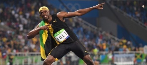 Jamaica's Usain Bolt celebrates after he won the Men's 100m Final during the athletics event at the Rio 2016 Olympic Games at the Olympic Stadium in Rio de Janeiro on August 14, 2016.   / AFP PHOTO / OLIVIER MORIN